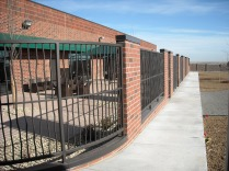 Commercial fencing with solid bar bent pickets, Thornton, CO.