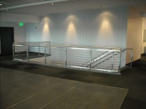 Commercial interior Stainless Steel guard/hand rails with horizontal solid bar infill.