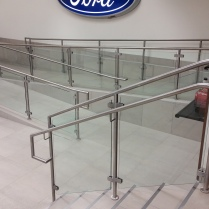 S/S ramp and stair rails with glass panels at a local FORD Dealership