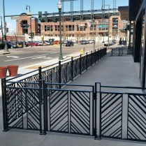 Downtown Denver railings at Kachina Restaurant, Coors Field in the backdrop.